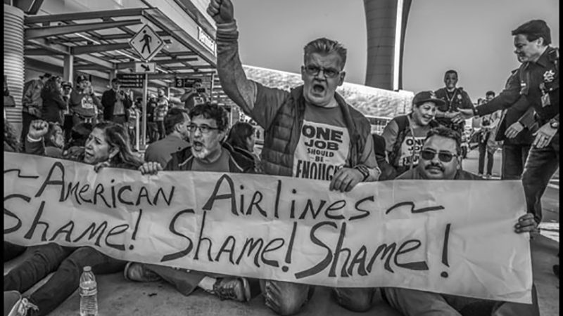 BARRED FROM STRIKING, AIRLINE FOOD WORKERS SIT DOWN IN TRAFFIC